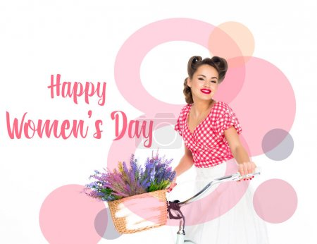Photo for Happy women`s day greeting card with attractive pin up woman on bicycle with basket of flowers isolated on white - Royalty Free Image