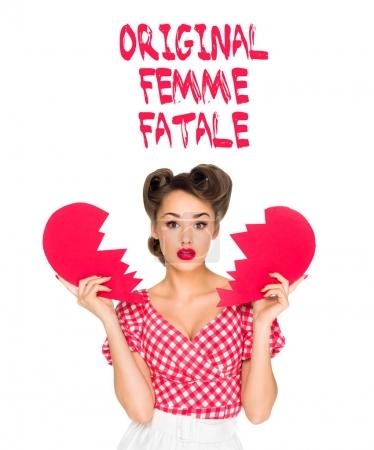 portrait of beautiful young woman in retro clothing with ripped paper heart and original femme fatale lettering isolated on white