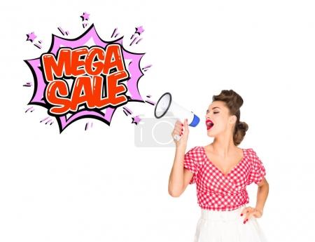 portrait of fashionable young woman in pin up style clothing with mega sale explode out of loudspeaker isolated on white