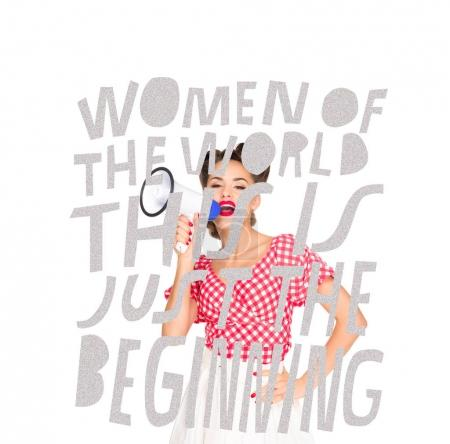 portrait of fashionable young woman in pin up style clothing with loudspeaker and feminism lettering on foreground isolated on white