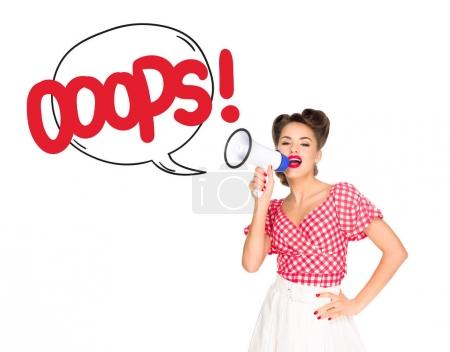 portrait of fashionable young woman in pin up style clothing with oops speech bubble out of loudspeaker isolated on white