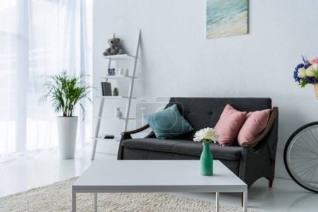 Photo for View of stylish living room with coffee table, green plant and sofa - Royalty Free Image
