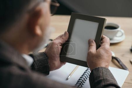 close-up shot of senior man looking at blank frame