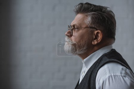 side view of thoughtful senior man looking away