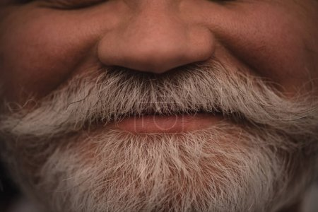 cropped shot of smiling senior man with grey beard