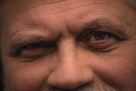 close-up shot of man looking at camera with sceptic expression