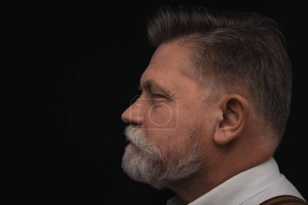 Photo for Side view of senior man with stylish beard isolated on black - Royalty Free Image