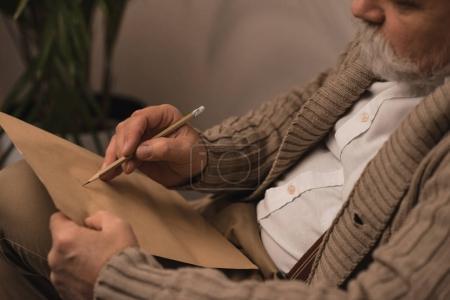 Photo for Close-up shot of bearded senior man writing letter - Royalty Free Image