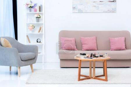 cozy stylish interior and various cosmetics on table