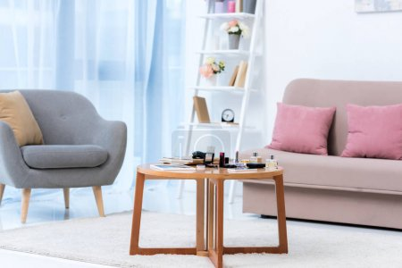 modern stylish interior and various cosmetics on table
