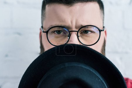 Photo for Obscured view of stylish man in eyeglasses with hat - Royalty Free Image