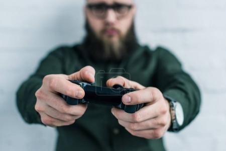 selective focus of businessman with gamepad in hands