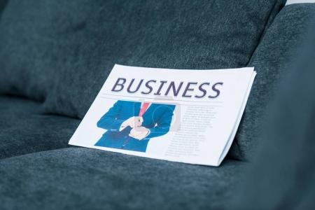close up view of business newspaper on grey sofa