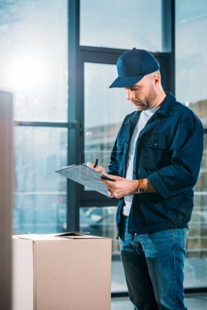 Delivery man filling cargo declaration
