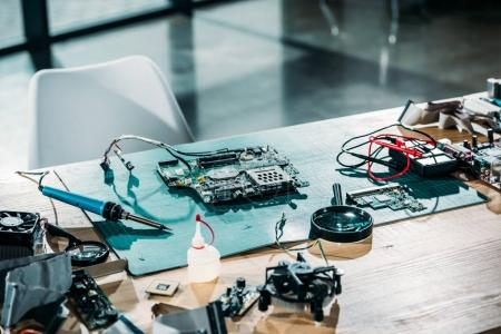 Photo for Engineer workplace with circuit board and soldering equipment - Royalty Free Image