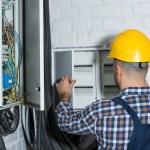 Male electrician repairing circuit line...