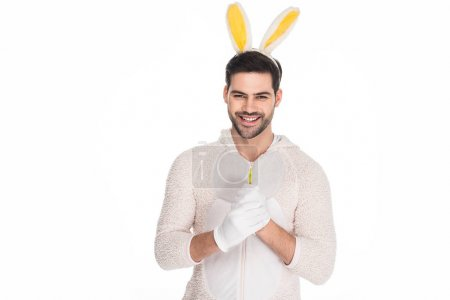 Smiling young man in costume of rabbit isolated on white, easter concept