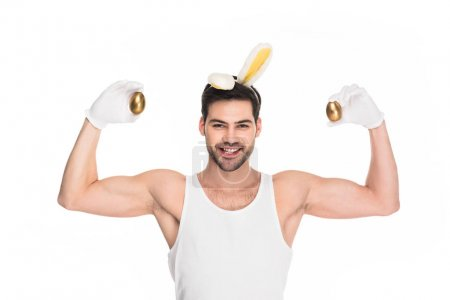 Man with bunny ears showing muscles and holding go...