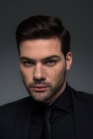 Headshot of stylish man in suit isolated on grey