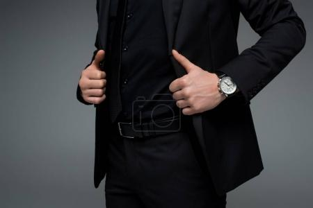 Photo for Partial view of male hands holding jacket isolated on grey - Royalty Free Image