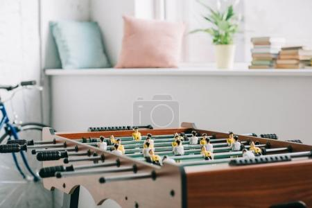 table football and bicycle in living room