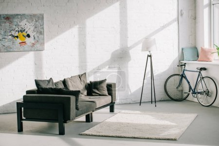 Photo for Interior of living room with sofa and bicycle - Royalty Free Image