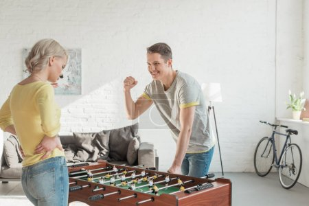 boyfriend showing yes gesture when winning table football game