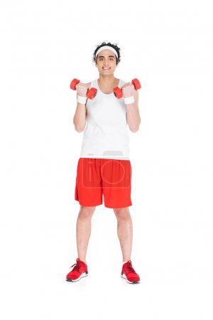 Young thin man in sportswear holding dumbbells isolated on white