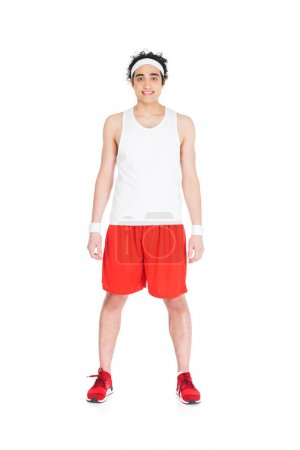 Young skinny man in jogging shoes and shorts standing isolated on white