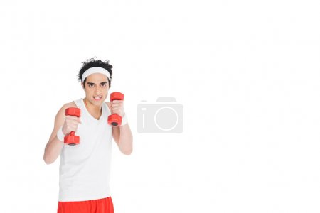 Young skinny man in sportswear holding dumbbels isolated on white