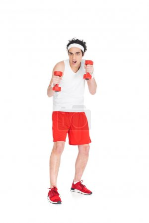 Skinny man in sporstwear exercising with dumbbells isolated on white