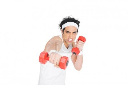 Portrait of skinny man in sporstwear exercising with dumbbells isolated on white