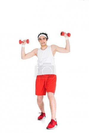 Young thin man in sportswear with dumbbels in hands isolated on white