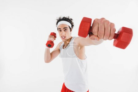 Thin sportsman exercising with dumbbells isolated on white
