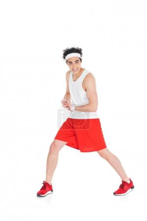 Young skinny sportsman showing muscles on hand isolated on white