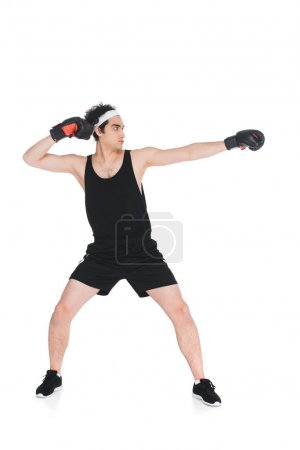 Side view of skinny young boxer preparing to hit isolated on white