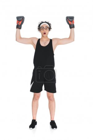 Young thin boxer in eyeglasses standing with arms up isolated onn white