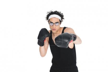 Young thin boxer in eyeglasses beating by hand isolated on white