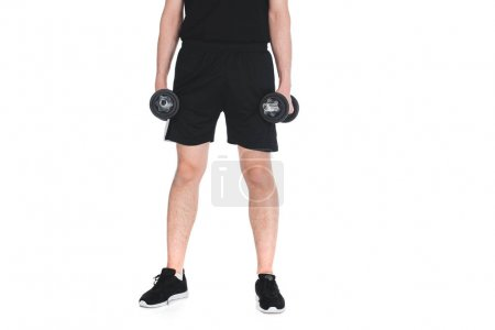 Cropped image of skinny sportsman with dumbbells in hands isolated on white