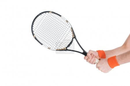 Cropped image of tennis player holding racket isolated on white