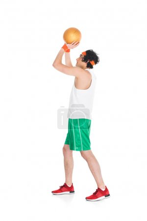 Profile of thin basketball player preparing to throw ball isolated on white