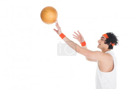 Photo for Profile of smiling thin sportsman throwing ball isolated on white - Royalty Free Image