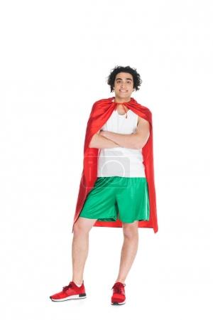 Young thin sprotsman standing in red cape isolated onn white