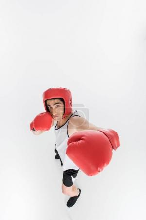 High angle view of skinny sportsman in boxing gloves and helmet isolated on white