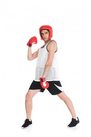 Thin sportsman in boxing gloves and helmet standing isolated on white