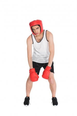 Tired young boxer in gloves and helmet isolated on white