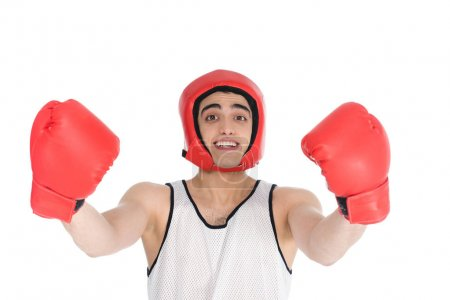 Young skinny sportsman in boxing helmet and gloves isolated on white