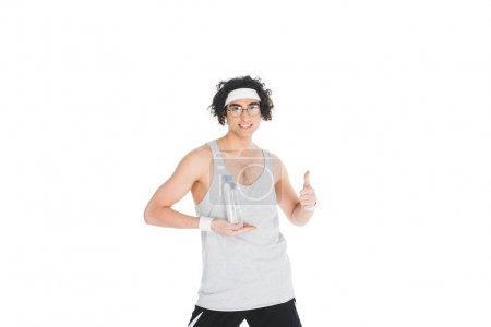 Young thin sportsman in eyeglasses holding bottle of water isolated on white