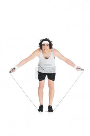 Photo for Thin sportsman in eyeglasses standing on jump rope isolated on white - Royalty Free Image