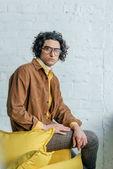 Portrait of male fashion model with eyeglasses